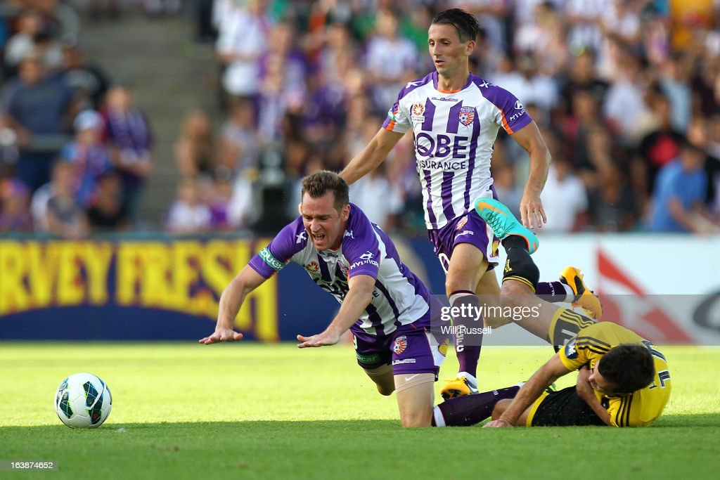 Shane Smeltz of the Glory is brought down by Ian Hogg of the Wellington Phoenix during the round 25 A-League match between the Perth Glory and the Wellington Phoenix at nib Stadium on March 17, 2013 in Perth, Australia.
