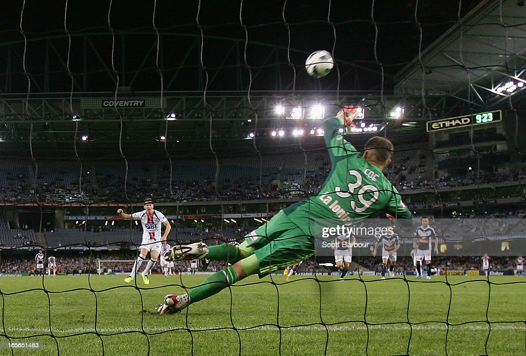 <a gi-track='captionPersonalityLinkClicked' href=/galleries/search?phrase=Shane+Smeltz&family=editorial&specificpeople=881773 ng-click='$event.stopPropagation()'>Shane Smeltz</a> of the Glory misses a shot at goal from the penalty spot as Victory goalkeeper Nathan Coe dives during the A-League Elimination final match between the Melbourne Victory and Perth Glory at Etihad Stadium on April 5, 2013 in Melbourne, Australia.