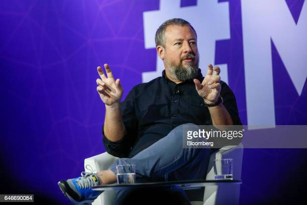 Shane Smith cofounder and chief executive officer of Vice Media Inc gestures while speaking on the third day of Mobile World Congress in Barcelona...