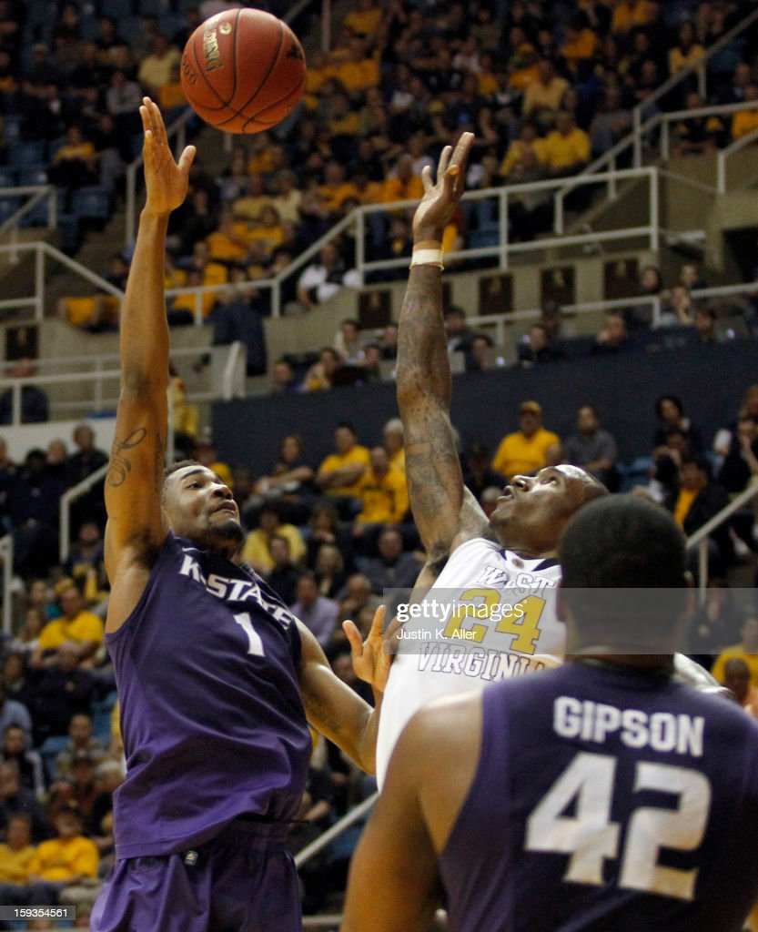 Shane Southwell #1 of the Kansas State Wildcats drives to the basket against the West Virginia Mountaineers at the WVU Coliseum on January 12, 2013 in Morgantown, West Virginia. Kansas State defeated West Virginia 65-64.
