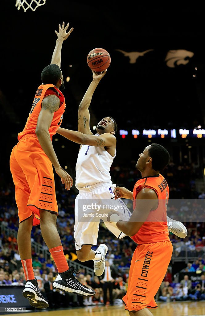 Shane Southwell #1 of the Kansas State Wildcats shoots against Michael Cobbins #20 and Brian Williams #4 of the Oklahoma State Cowboys in the second half during the Semifinals of the Big 12 basketball tournament at the Sprint Center on March 15, 2013 in Kansas City, Missouri.