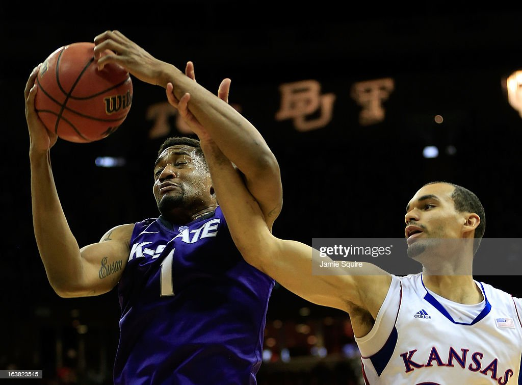 Shane Southwell #1 of the Kansas State Wildcats tries to shoot against Perry Ellis #34 of the Kansas Jayhawks in the second half during the Final of the Big 12 basketball tournament at Sprint Center on March 16, 2013 in Kansas City, Missouri.