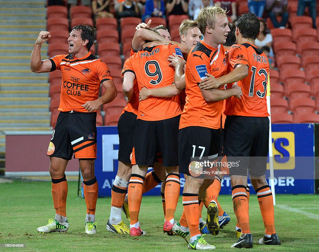 Shane Stefanutto (L) of the Roar celebrates after a goal during the round 19 A-League match between the Brisbane Roar and the Central Coast Mariners at Suncorp Stadium on February 1, 2013 in Brisbane, Australia.