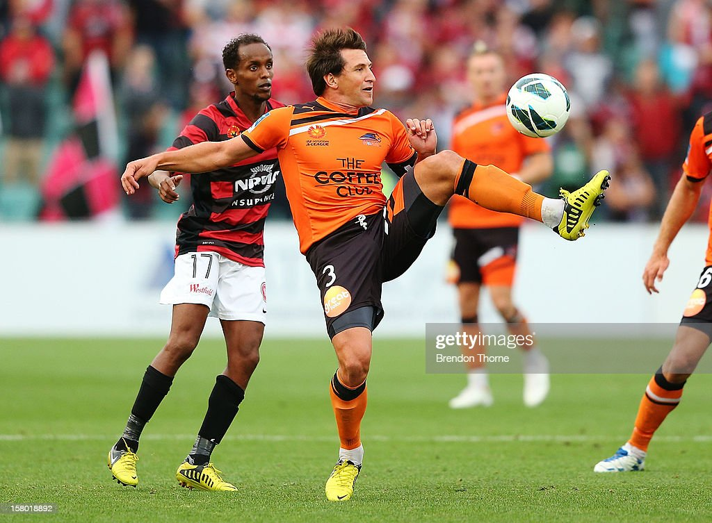 Shane Stefanutto of the Roar competes with Youssouf Hersi of the Wanderers during the round ten A-League match between the Western Sydney Wanderers and the Brisbane Roar at Parramatta Stadium on December 9, 2012 in Sydney, Australia.