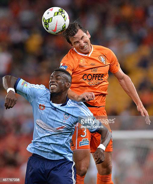 Shane Stefanutto of the Roar gets above Bernie IbiniIsei of Sydney during the round three ALeague match between Brisbane Roar and Sydney FC at...