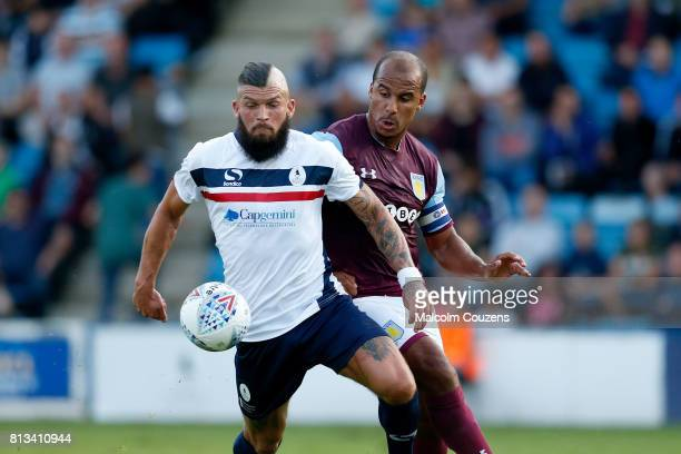 Shane Sutton of AFC Telford United competes with Gabriel Agbonlahor of Aston Villa during the PreSeason Friendly between AFC Telford United and Aston...