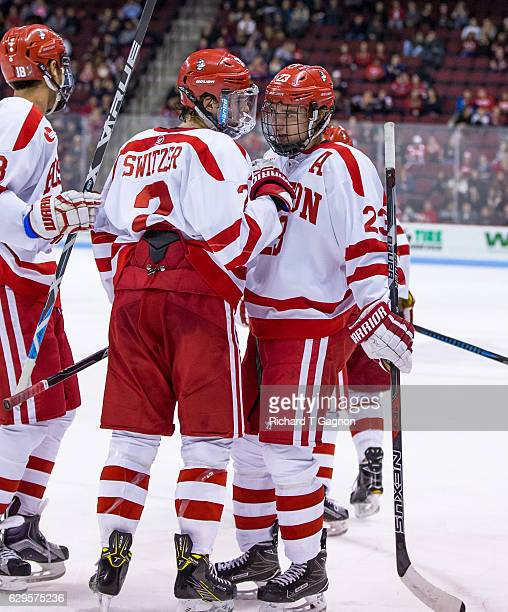 Shane Switzer of the Boston University Terriers celebrates his first collegiate goal against the Yale Bulldogs with his teammates Jakob Forsbacka...