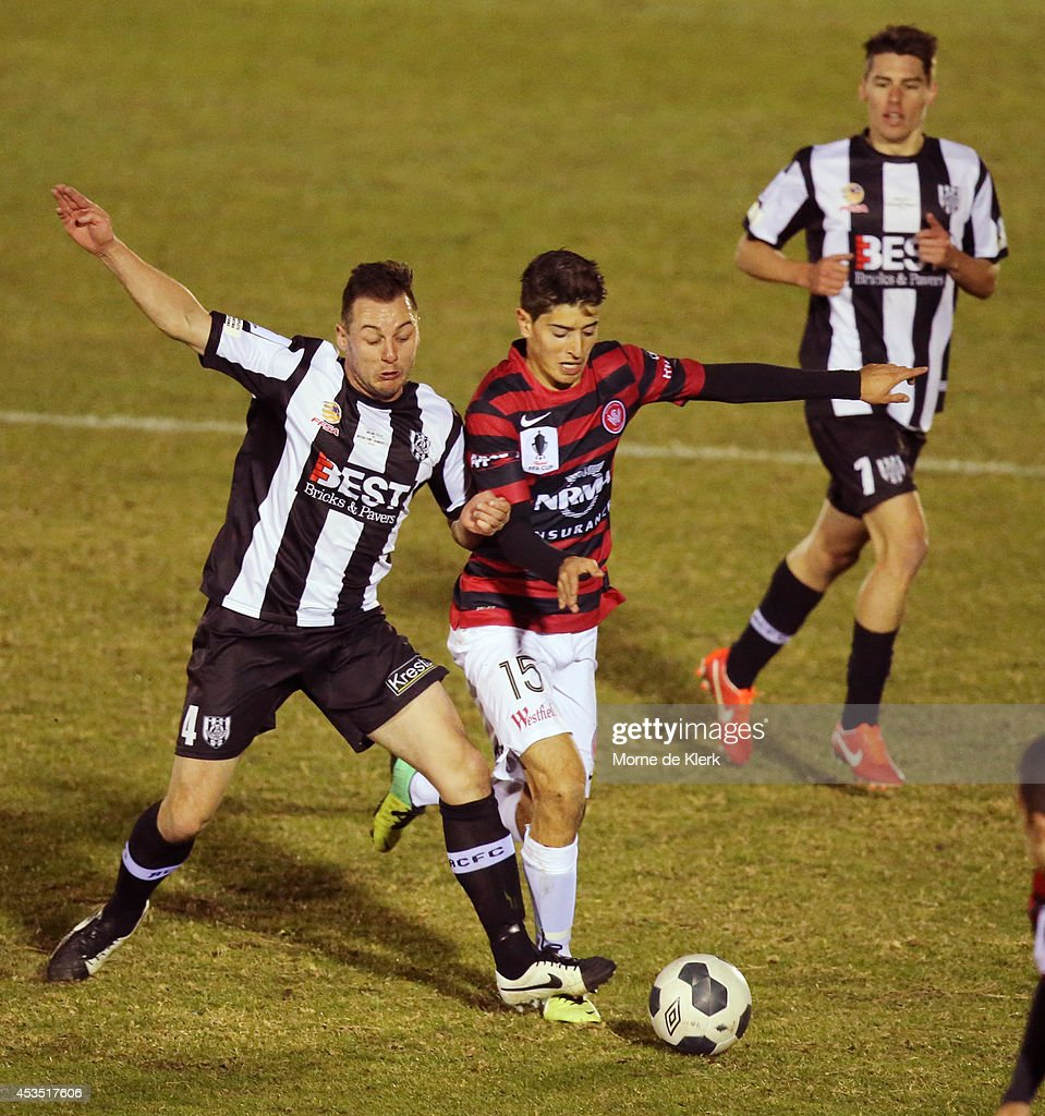 Shane Tobias of Adelaide City competes for the ball with Yianni Perkatis of Western Sydney during the FFA Cup match between Adelaide City and Western Sydney Wanderers at Marden Sports Complex on August 12, 2014 in Adelaide, Australia.