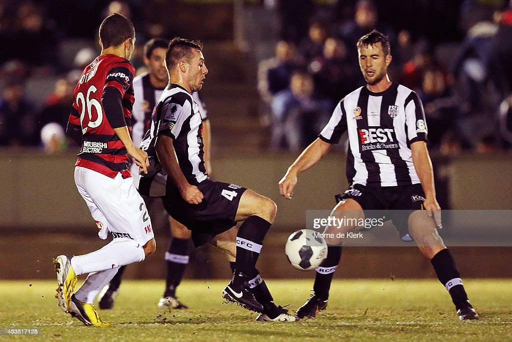 Shane Tobias of Adelaide City runs with the ball during the FFA Cup match between Adelaide City and Western Sydney Wanderers at Marden Sports Complex on August 12, 2014 in Adelaide, Australia.