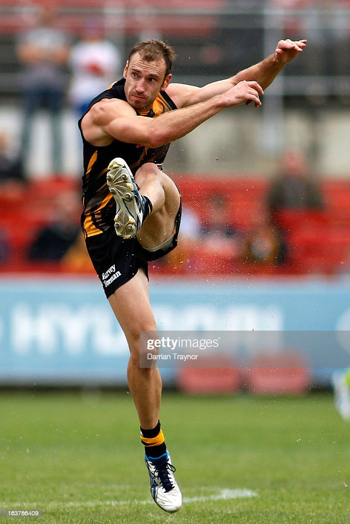<a gi-track='captionPersonalityLinkClicked' href=/galleries/search?phrase=Shane+Tuck&family=editorial&specificpeople=561249 ng-click='$event.stopPropagation()'>Shane Tuck</a> of the tigers kicks the ball during the AFL practice match between the Richmond Tigers and the Western Bulldogs at Visy Park on March 16, 2013 in Melbourne, Australia.