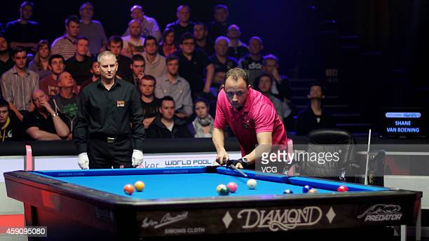 Shane Van Boening of USA plays a shot against Nikos Ekonomopoulos of Greece during the final 2014 Partypoker World Pool Masters on November 16 2014...