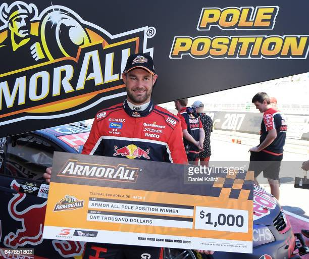 Shane Van Gisbergen driver of the Red Bull Holden Racing Team Holden Commodore VF reacts after taking pole position for race 1 of the Clipsal 500...