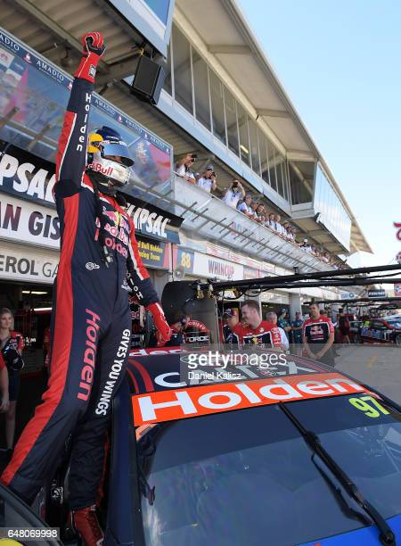Shane Van Gisbergen driver of the Red Bull Holden Racing Team Holden Commodore VF celebrates after taking pole position for race 2 of the Clipsal 500...