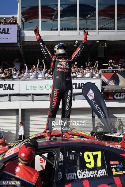 Shane Van Gisbergen driver of the Red Bull Holden Racing Team Holden Commodore VF celebrates after winning race 2 for the Clipsal 500 which is part...