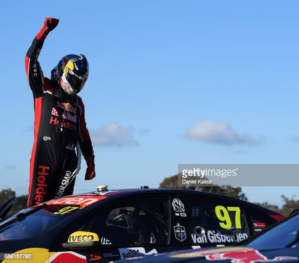 Shane Van Gisbergen driver of the Red Bull Holden Racing Team Holden Commodore VF celebrates after winning race 10 for the Winton SuperSprint which...
