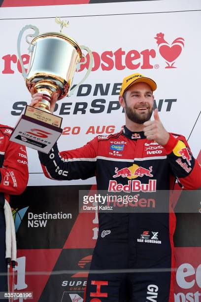 Shane Van Gisbergen driver of the Red Bull Holden Racing Team Holden Commodore VF celebrates on the podium after race 18 for the Sydney SuperSprint...