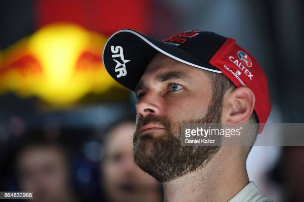 Shane Van Gisbergen driver of the Red Bull Holden Racing Team Holden Commodore VF looks on during the top ten shoot out for race 22 for the Gold...