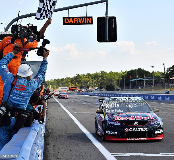 Shane Van Gisbergen driver of the Red Bull Racing Australia Holden Commodore VF takes the chequered flag to win race 2 for the V8 Supercars Darwin...