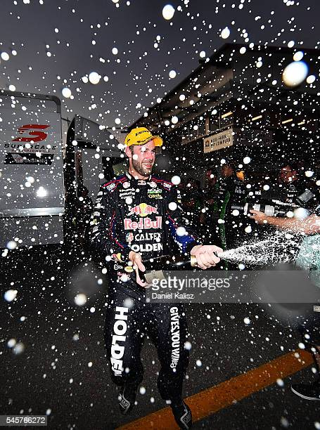 Shane Van Gisbergen driver of the Red Bull Racing Australia Holden Commodore VF celebrates after winning race 2 for the Townsville 400 at Reid Park...