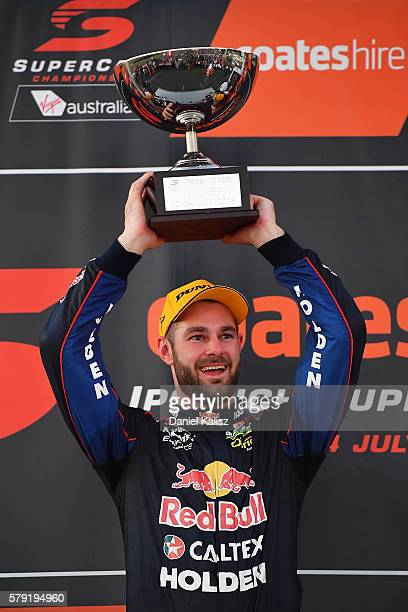 Shane Van Gisbergen driver of the Red Bull Racing Australia Holden Commodore VF celebrates after winning race 1 for the V8 Supercars Ipswich...