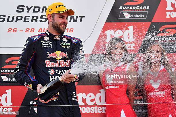 Shane Van Gisbergen driver of the Red Bull Racing Australia Holden Commodore VF celebrates on the podium after winning race 1 for the V8 Supercars...