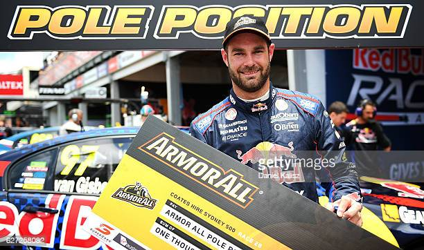 Shane Van Gisbergen driver of the Red Bull Racing Australia Holden Commodore VF celebrates after taking pole position for race 28 during qualifying...