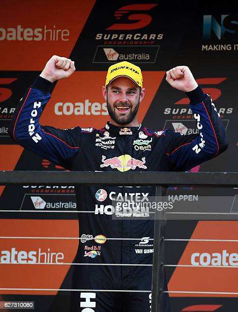 Shane Van Gisbergen driver of the Red Bull Racing Australia Holden Commodore VF reacts on the podium after finishing in 3rd place and winning the...