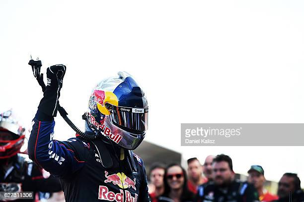Shane Van Gisbergen driver of the Red Bull Racing Australia Holden Commodore VF reacts after finishing in 3rd place and winning the Drivers...