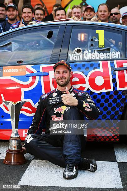 Shane Van Gisbergen driver of the Red Bull Racing Australia Holden Commodore VF celebrates after winning race 29 and the Supercars Drivers...