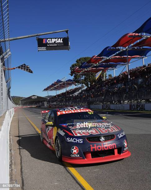 Shane Van Gisbergen drives the Red Bull Holden Racing Team Holden Commodore VF takes the chequered flag to win race 1 for the Clipsal 500 which is...