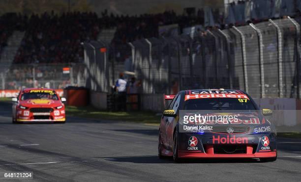Shane Van Gisbergen drives the Red Bull Holden Racing Team Holden Commodore VF leads Scott McLaughlin drives the Shell VPower Racing Team Ford Falcon...