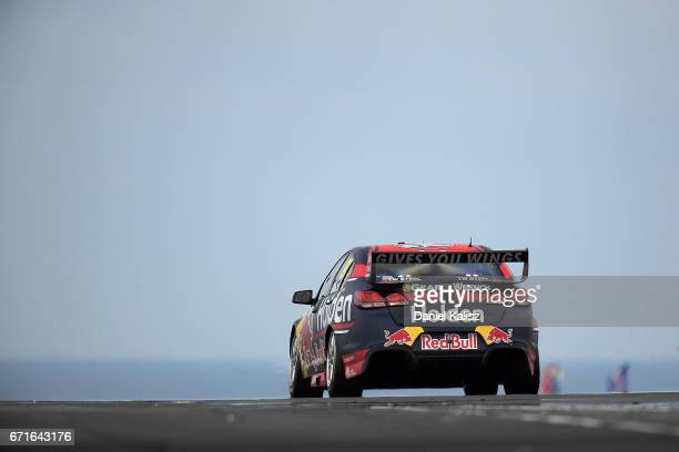 Shane Van Gisbergen drives the Red Bull Holden Racing Team Holden Commodore VF during qualifying for race 5 for the Phillip Island 500 which is part...