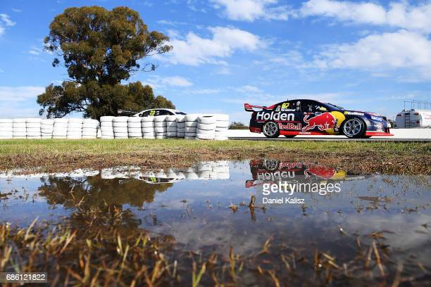 Shane Van Gisbergen drives the Red Bull Holden Racing Team Holden Commodore VF during qualifying for race 10 for the Winton SuperSprint which is part...