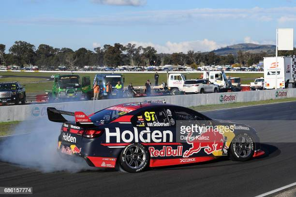 Shane Van Gisbergen drives the Red Bull Holden Racing Team Holden Commodore VF celebrates after winning race 10 for the Winton SuperSprint which is...