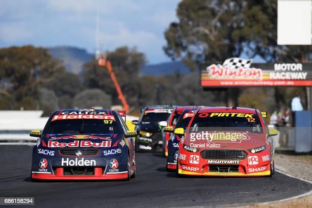 Shane Van Gisbergen drives the Red Bull Holden Racing Team Holden Commodore VF leads Fabian Coulthard drives the Shell VPower Racing Team Ford Falcon...