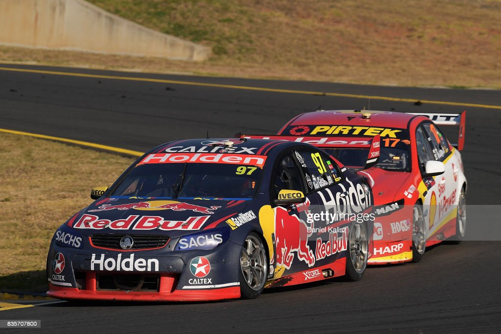 Shane Van Gisbergen drives the #97 Red Bull Holden Racing Team Holden Commodore VF leads Scott McLaughlin drives the #17 Shell V-Power Racing Team Ford Falcon FGX during race 18 for the Sydney SuperSprint, which is part of the Supercars Championship at Sydney Motorsport Park on August 20, 2017 in Sydney, Australia.