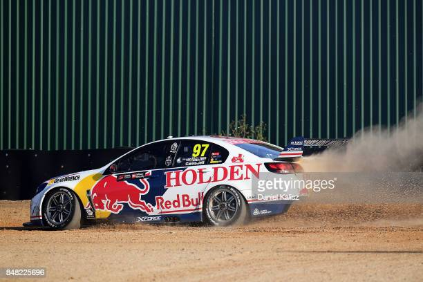 Shane Van Gisbergen drives the Red Bull Holden Racing Team Holden Commodore VF runs off th circuit with a tyre failure during the Sandown 500 which...