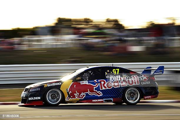 Shane Van Gisbergen drives the Red Bull Racing Australia Holden Commodore VF during Race 1 for the V8 Supercars Tasmania SuperSprint at Symmons...
