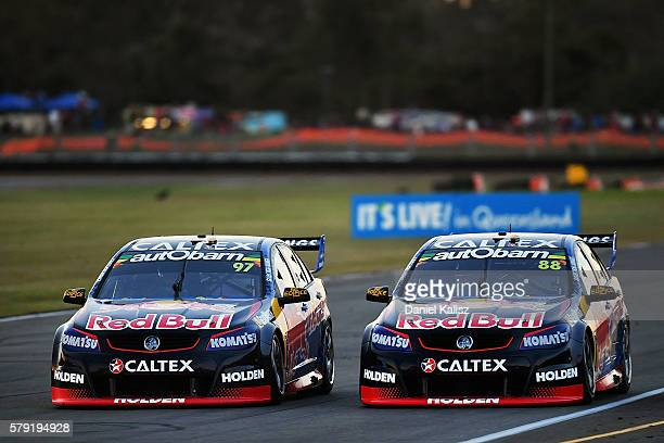 Shane Van Gisbergen drives the Red Bull Racing Australia Holden Commodore VF passes Jamie Whincup drives the Red Bull Racing Australia Holden...