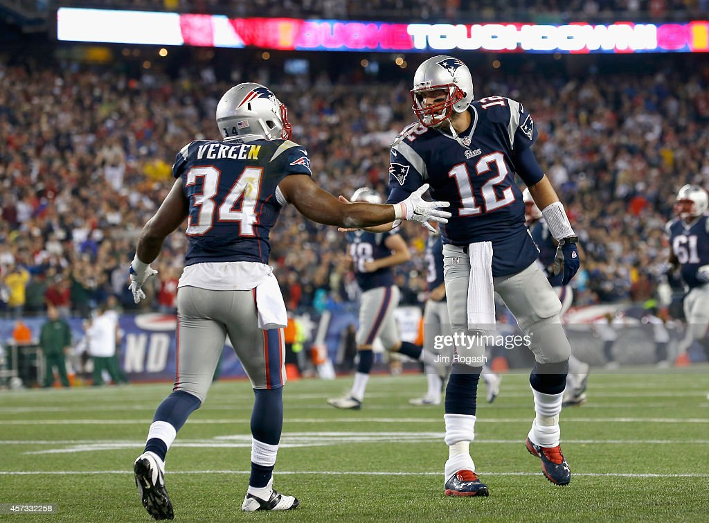 Shane Vereen and Tom Brady of the New England Patriots react after Vereen scored a touchdown during the second quarter against the New York Jets at...