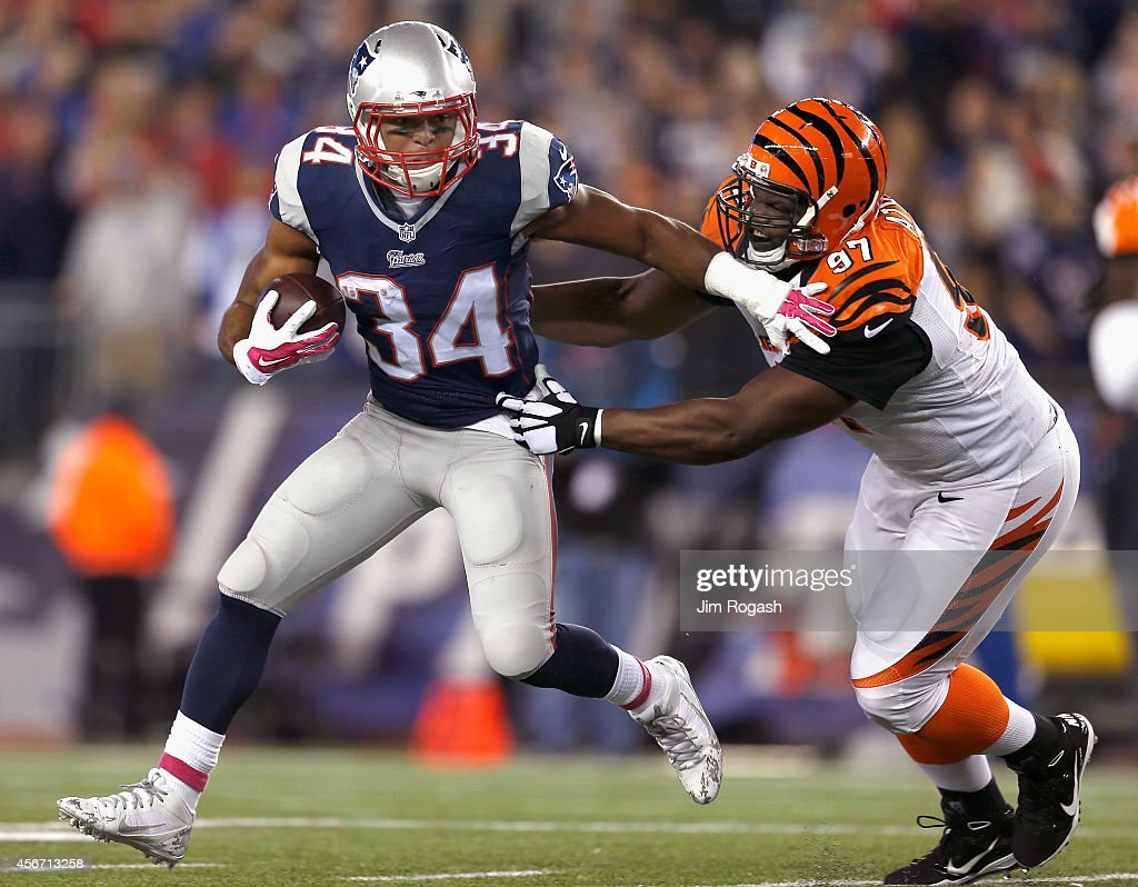 Shane Vereen of the New England Patriots carries the ball during the third quarter as Geno Atkins of the Cincinnati Bengals makes a tackle at...