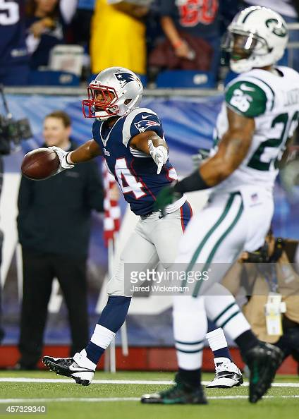 Shane Vereen of the New England Patriots celebrates after catching a touchdown pass during the first quarter against the New York Jets at Gillette...