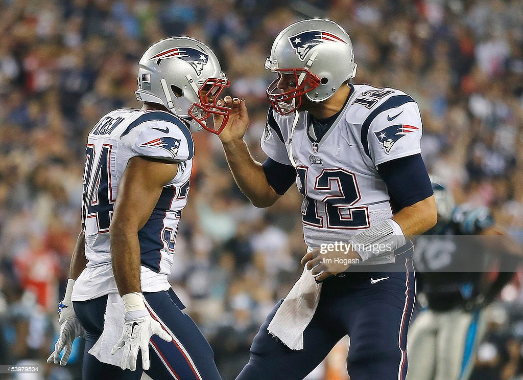 Shane Vereen of the New England Patriots celebrates his touchdown with Tom Brady during a preseason game with the Carolina Panthers in the second...