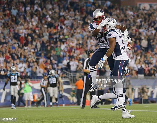 Shane Vereen of the New England Patriots celebrates his touchdown with James White during a preseason game with the Carolina Panthers in the second...
