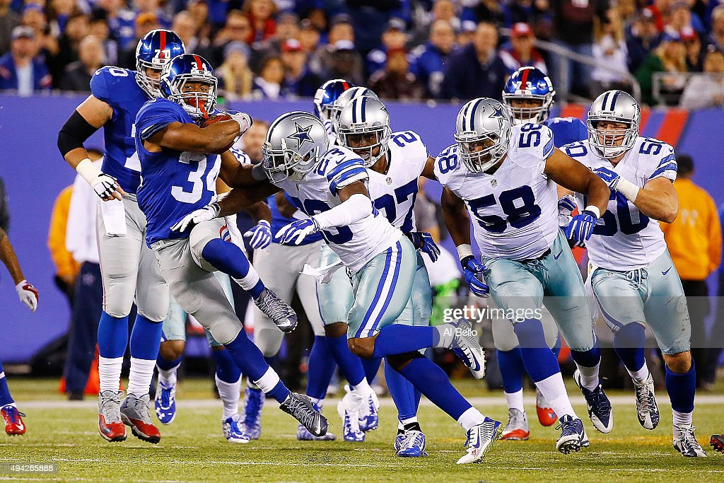 Shane Vereen #34 of the New York Giants is pursued by the Dallas Cowboys defense during the third quarter at MetLife Stadium on October 25, 2015 in East Rutherford, New Jersey. The New York Giants defeated the Dallas Cowboys 27-20.