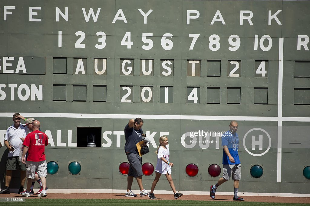 Shane Victorino giving friends a tour of the Green Monster before the Red Sox play the Seattle Mariners at Fenway Park on Sunday, August 24, 2014.