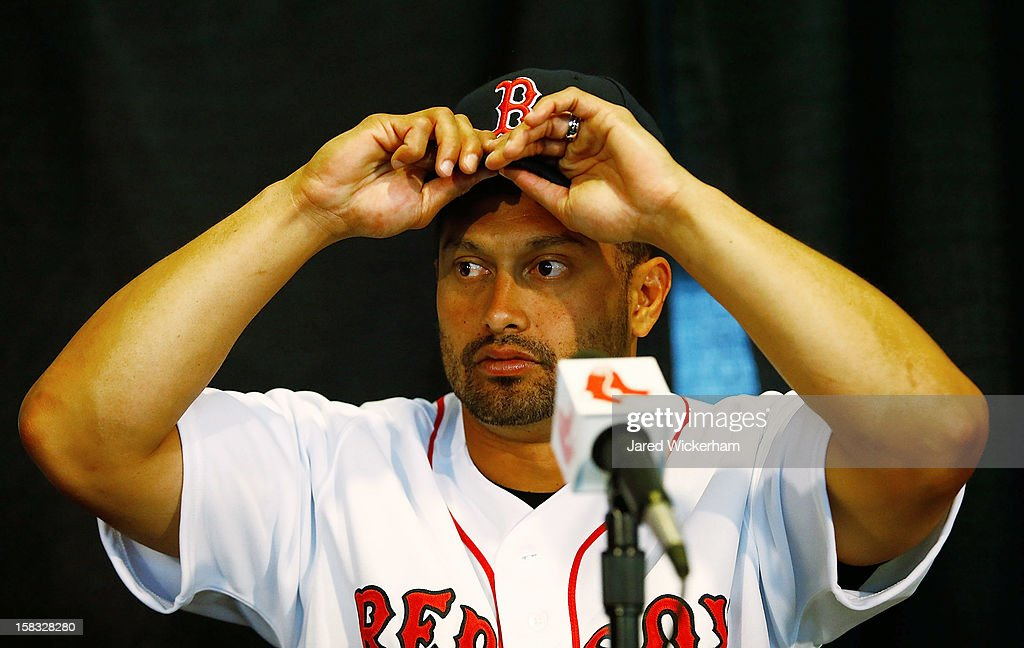 <a gi-track='captionPersonalityLinkClicked' href=/galleries/search?phrase=Shane+Victorino&family=editorial&specificpeople=576251 ng-click='$event.stopPropagation()'>Shane Victorino</a> of the Boston Red Sox adjusts his hat while speaking during a press conference, after signing a three-year contract, on December 13, 2012 at Fenway Park in Boston, Massachusetts.