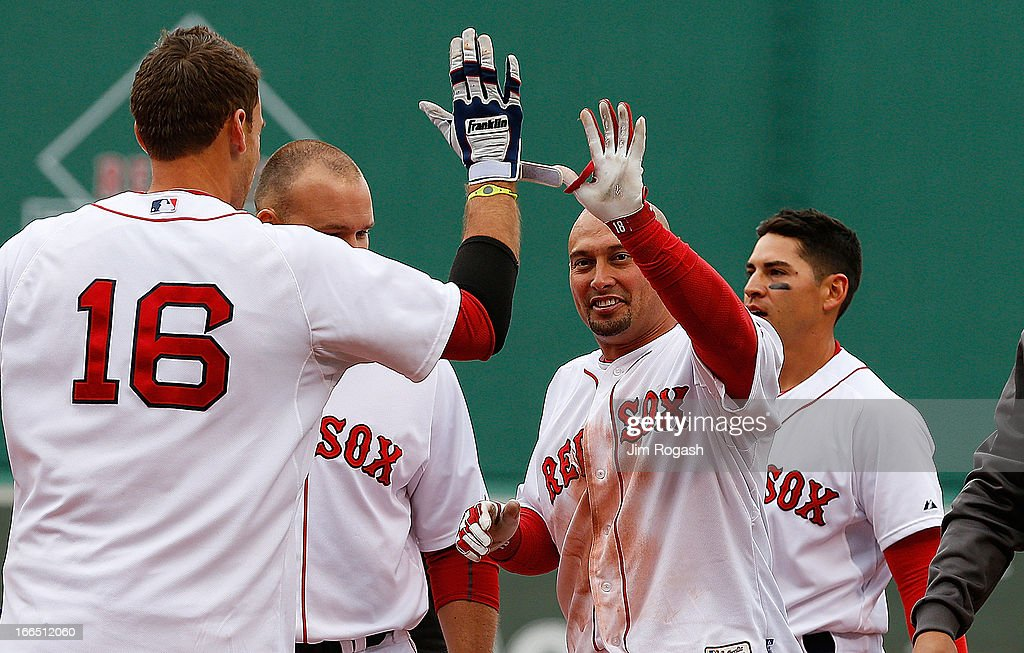 <a gi-track='captionPersonalityLinkClicked' href=/galleries/search?phrase=Shane+Victorino&family=editorial&specificpeople=576251 ng-click='$event.stopPropagation()'>Shane Victorino</a> #18 of the Boston Red Sox and <a gi-track='captionPersonalityLinkClicked' href=/galleries/search?phrase=Jacoby+Ellsbury&family=editorial&specificpeople=4172583 ng-click='$event.stopPropagation()'>Jacoby Ellsbury</a> #2 celebrate with <a gi-track='captionPersonalityLinkClicked' href=/galleries/search?phrase=Will+Middlebrooks&family=editorial&specificpeople=7934204 ng-click='$event.stopPropagation()'>Will Middlebrooks</a> after defeating the Tampa Bay Rays in the 10th inning, 2-1, at Fenway Park on April 13, 2013 in Boston, Massachusetts. Ellsbury scored the winning run on a single by <a gi-track='captionPersonalityLinkClicked' href=/galleries/search?phrase=Shane+Victorino&family=editorial&specificpeople=576251 ng-click='$event.stopPropagation()'>Shane Victorino</a> #18 of the Boston Red Sox in the 10th inning.