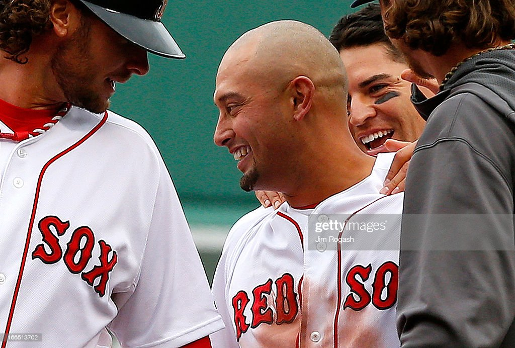 <a gi-track='captionPersonalityLinkClicked' href=/galleries/search?phrase=Shane+Victorino&family=editorial&specificpeople=576251 ng-click='$event.stopPropagation()'>Shane Victorino</a> #18 of the Boston Red Sox and <a gi-track='captionPersonalityLinkClicked' href=/galleries/search?phrase=Jacoby+Ellsbury&family=editorial&specificpeople=4172583 ng-click='$event.stopPropagation()'>Jacoby Ellsbury</a> #2 celebrate with teammates after defeating the Tampa Bay Rays in the 10th inning, 2-1, at Fenway Park on April 13, 2013 in Boston, Massachusetts. Ellsbury scored the winning run on a single by <a gi-track='captionPersonalityLinkClicked' href=/galleries/search?phrase=Shane+Victorino&family=editorial&specificpeople=576251 ng-click='$event.stopPropagation()'>Shane Victorino</a> #18 of the Boston Red Sox in the 10th inning.