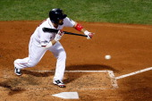 Shane Victorino of the Boston Red Sox bunts the ball against Max Scherzer of the Detroit Tigers in the third inning hits a by during Game Six of the...